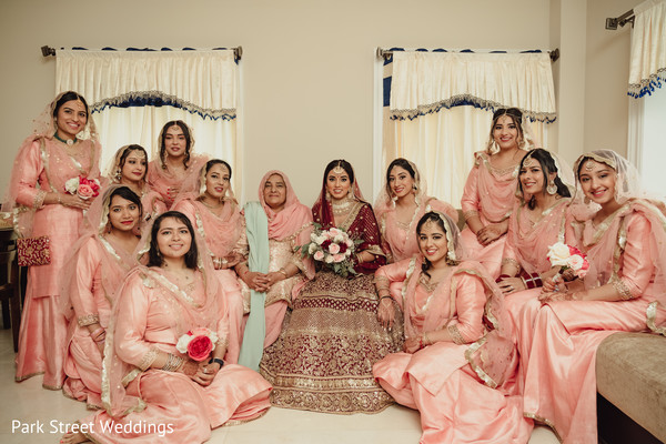 Indian bride and bridesmaids posing for pictures.