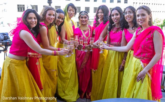 Joyful Indian bride and bridesmaids having cheers.