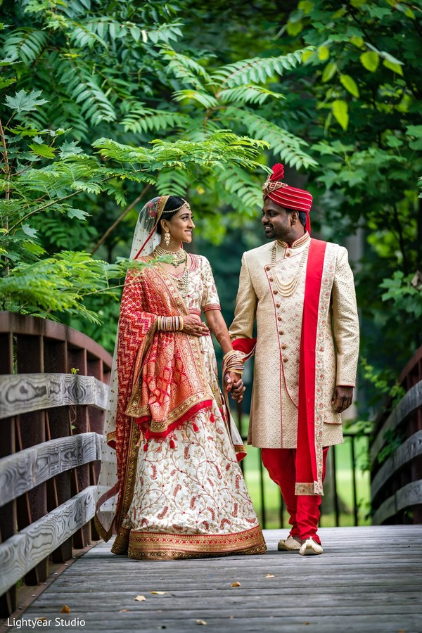 Elegant indian bride and groom wedding ceremony outfit