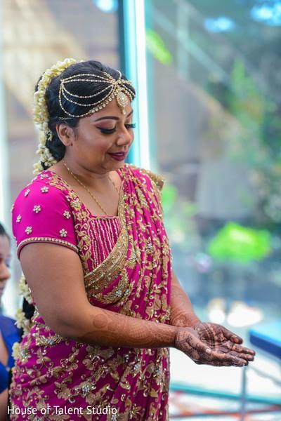 Indian bride wearing the mehndi.
