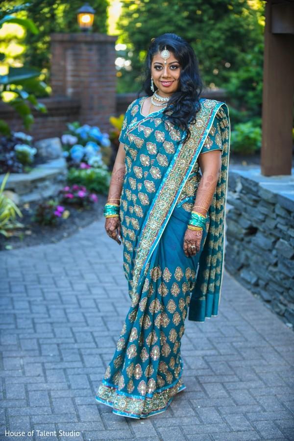 Indian bride wearing the saree.