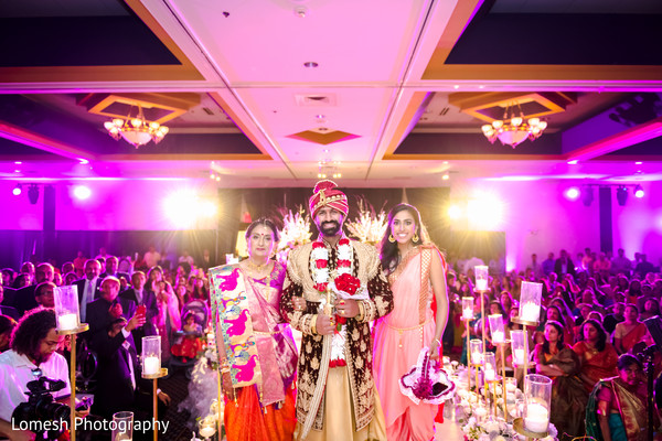 Indian groom with special guests during the reception.