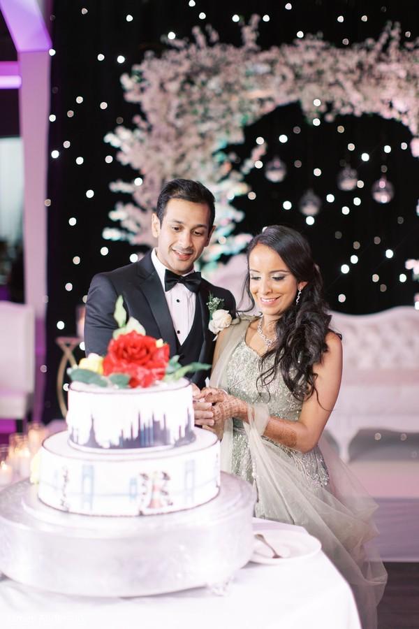 Indian wedding cutting the cake scene