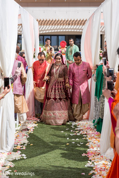 Gorgeous Maharani escorted down the aisle.