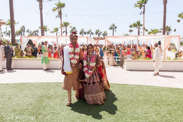 Lovely Indian couple walking out of the wedding ceremony.