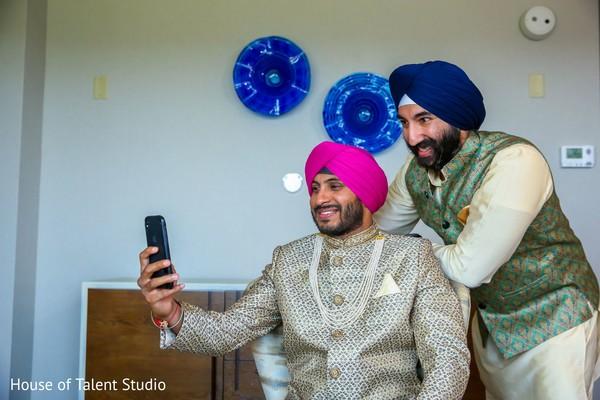 Charming Indian groom taking a selfie.
