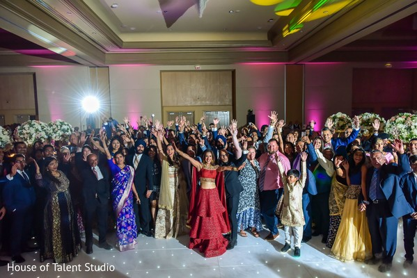 Vibrant indian couple  with guests at reception party capture.