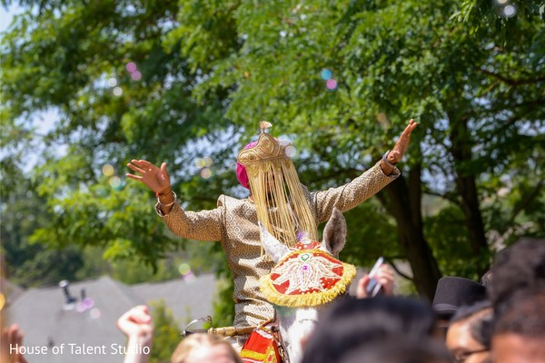 Enchanting Indian groom riding his baraat horse.