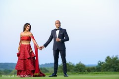 Sweet Indian bride and groom posing for photo shoot.