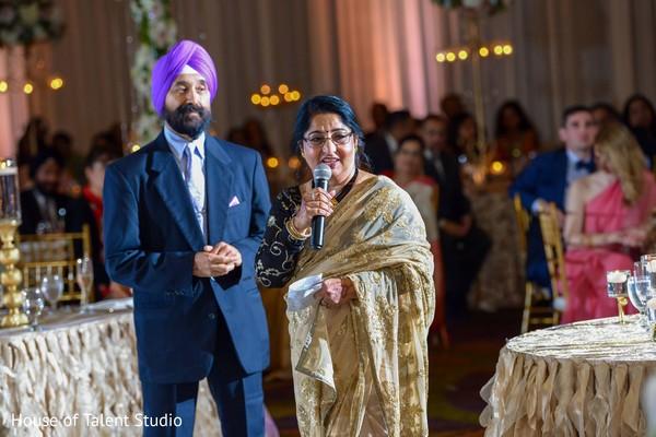 Indian parents at reception speech capture.