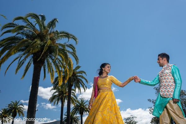 Indian bride and groom posing outside.