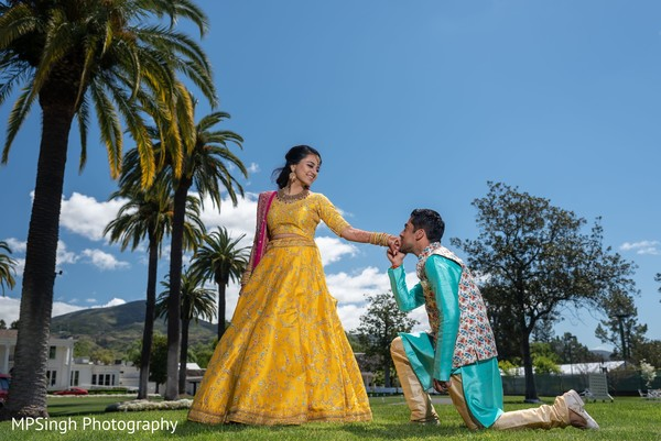Indian bride and groom posing for pictures.