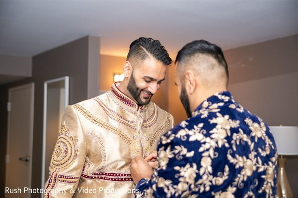 Charming Indian groom getting ready.