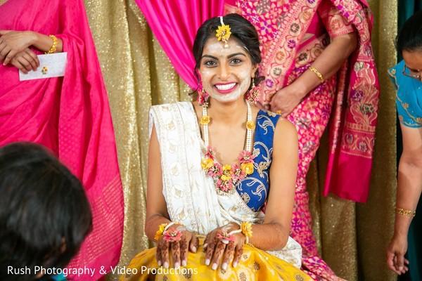 Joyful indian bride's pre-wedding ritual.