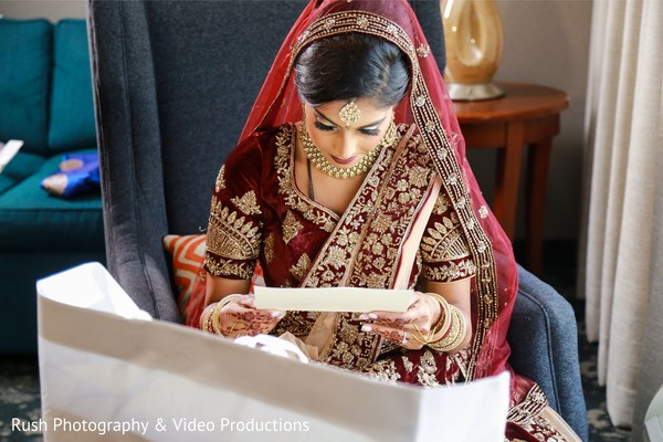 Indian bride reading grooms letter.