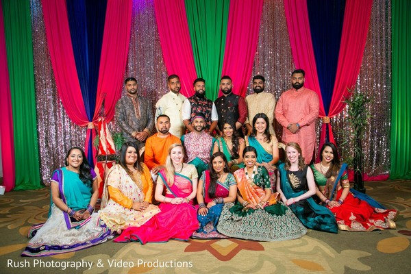 Sangeet photo of Indian couple  with bridesmaids and groomsmen.