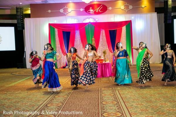 Indian bridesmaids performing a sangeet dance.