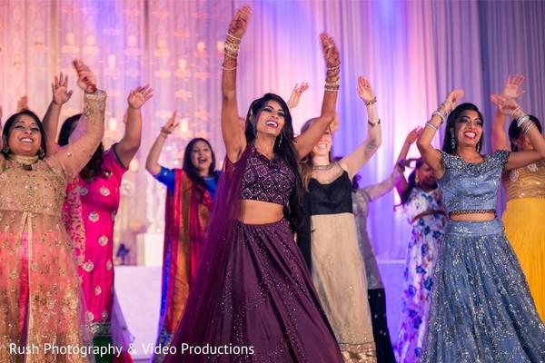 Upbeat Indian bride and bridesmaids reception dance.
