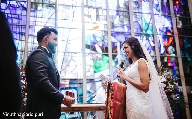 Joyful Maharani reading her bows to her groom.