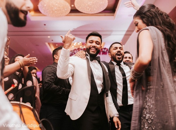 Indian groom looks so happy at his reception party.