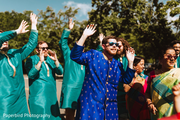 Indian groom with groomsmen during baraat
