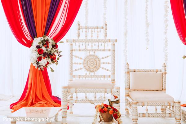Closeup capture of Indian wedding ceremony mandap seats.