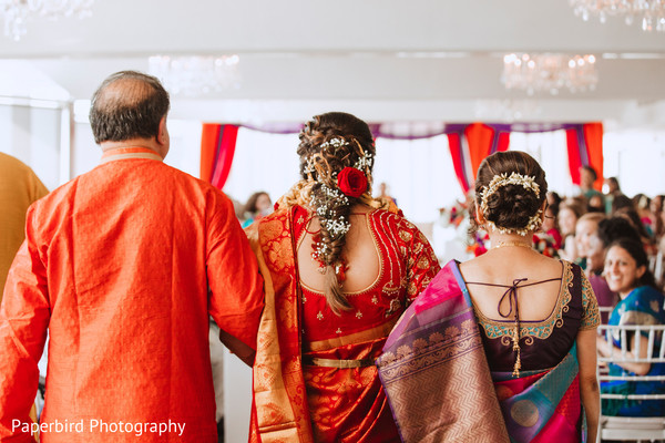 Indian brides entrance to wedding ceremony unforgettable moment.
