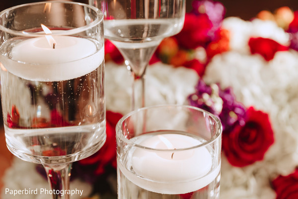 Elegant Indian wedding reception candles decor.