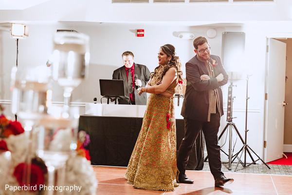 Joyful indian couple dance photo.