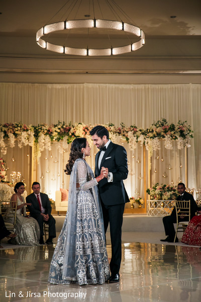 Indian bride and groom having their first dance.