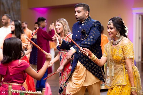 Indian couple enjoying the Sangeet celebration.