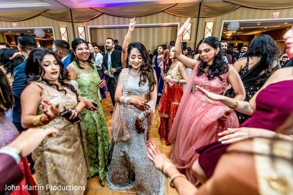 Indian bridesmaids having fun at reception party.