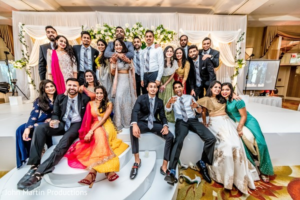 Indian couple with their loved guests at reception.