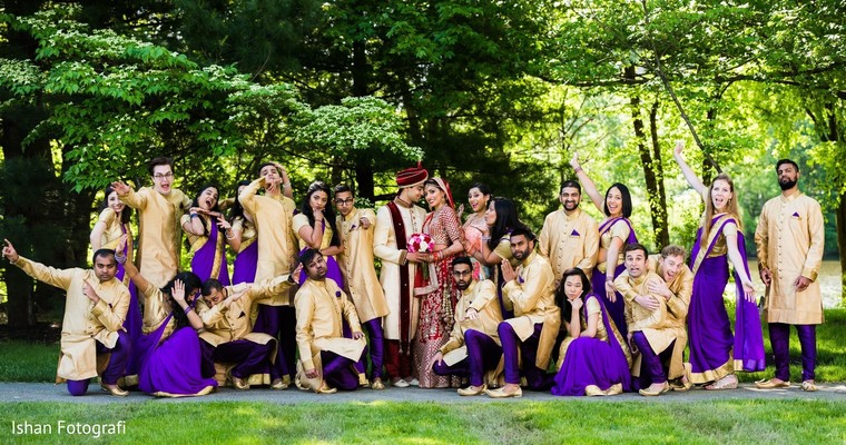 Upbeat indian bride and groom with bridesmaids and groomsmen capture
