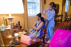 Indian bride getting her hair done.