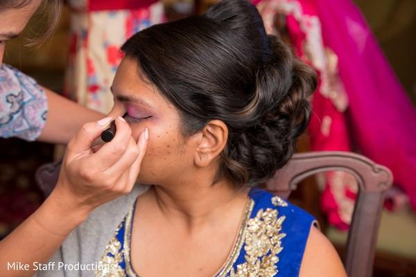 Maharani getting her eyes makeup.