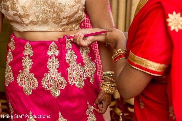 Indian bride getting her lehenga on.