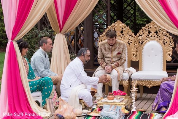 Coconut ritual at India wedding Dwar Puja.