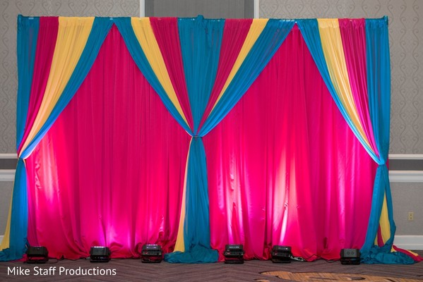 Creative Indian wedding stage draping and lights decoration.