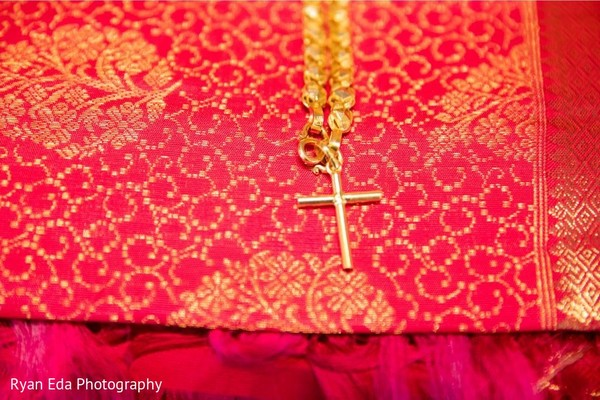 Closeup capture of Indian wedding ceremony chain with cross.