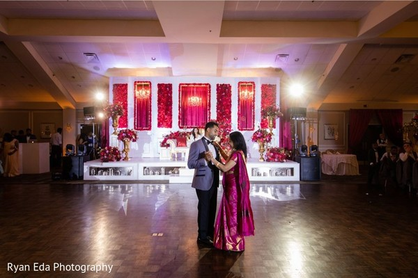 Indian groom dancing with his mother capture.