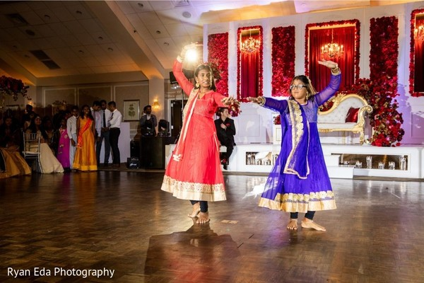 Lovely Indian girls dancing at wedding reception.