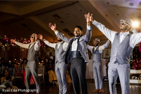 Indian groom and groomsmen during reception dance.