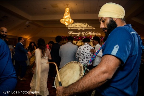 Dhol player during reception dance.