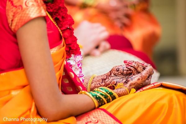 Closeup capture of maharanis hands with mehndi art.