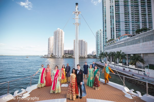 Gorgeous Indian couple with bridesmaids and groomsmen.