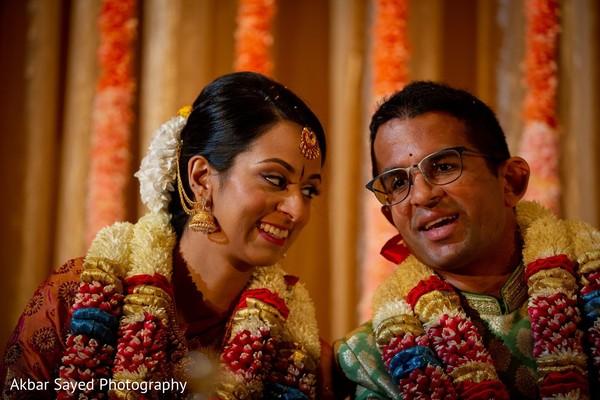 Joyful indian bride and groom capture