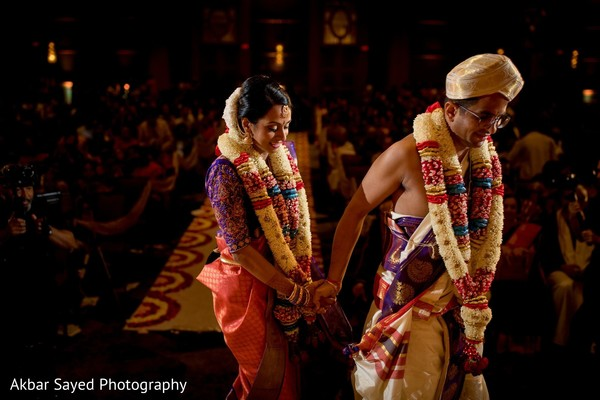 Indian bride and groom walking the seven steps around sacred fire