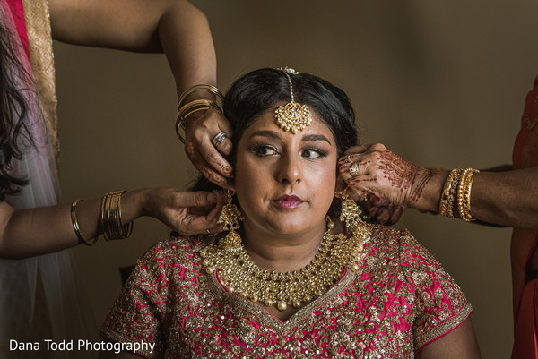 Indian bride being assisted by special guests.