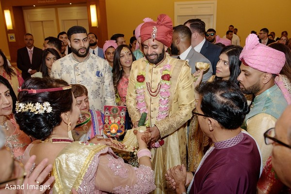 Indian groom being greeted at baraat.